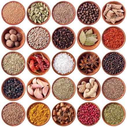set of wooden bowls full of different spices isolated on white background